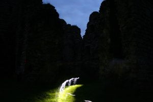 will-o'-the-wisp anomaly caused by a torchbeam carried by an investigator crossing a long exposure photograph